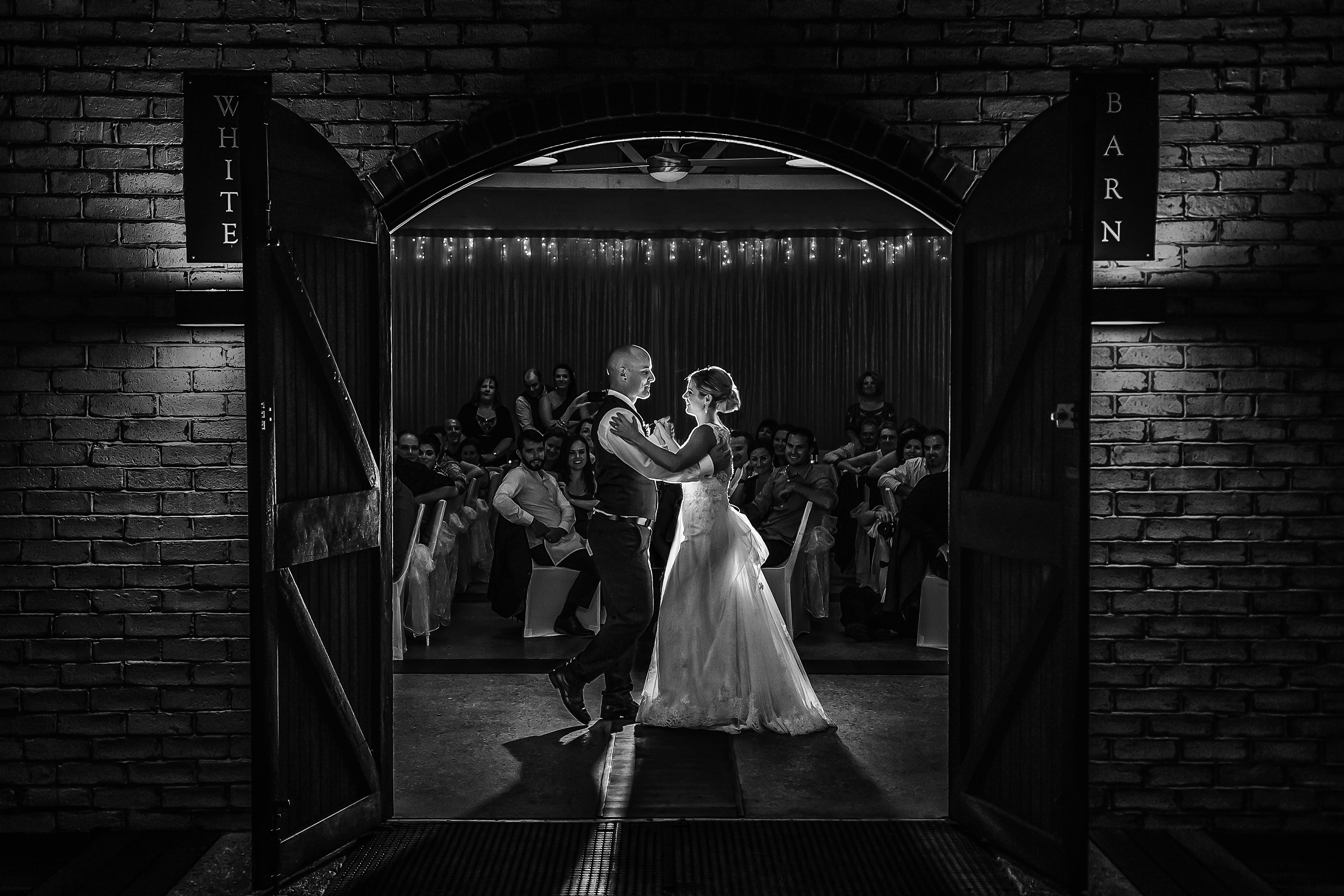 Married Wedding couple dance in the White Barn reception room at The Rose & Crown in Guildford