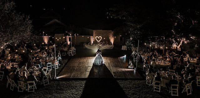 Perth Award Winning Documentary Wedding Photographer Adam Levi Browne photographs an aerial photograph of a bride and groom dancing in the backyard DIY wedding