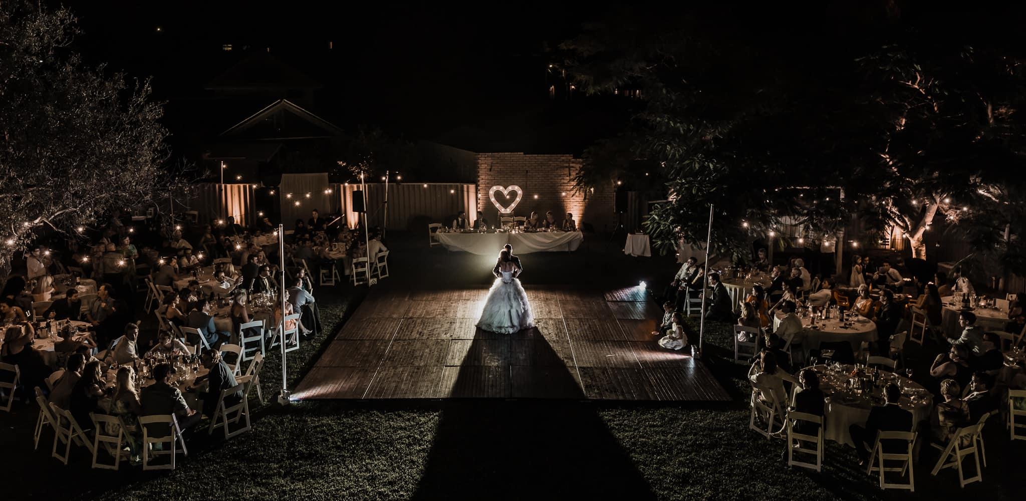 Perth Award Winning Documentary Wedding Photographer Adam Levi Browne photographs an aerial photograph of a bride and groom dancing in the backyard DIY wedding