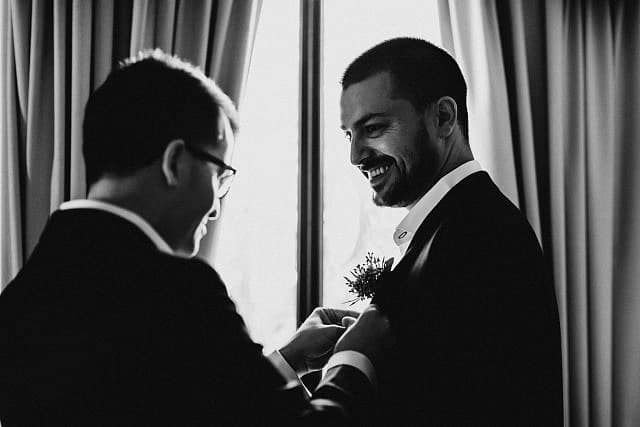Henley Brook Wedding Photographer at Albion on the Swan Groomsmen sharing moment
