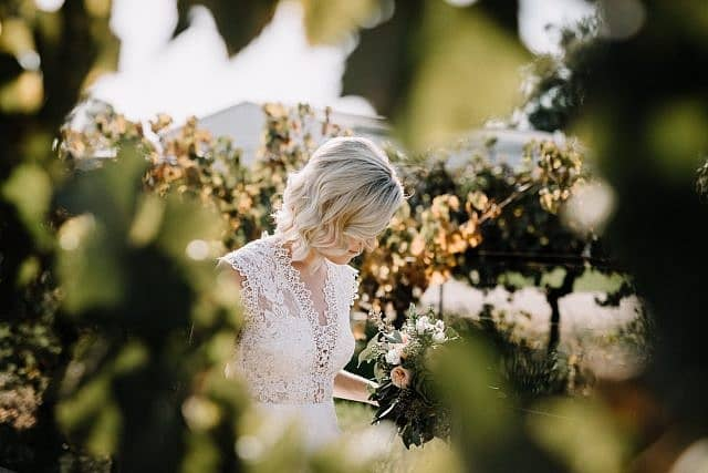 Bride walks the the vines
