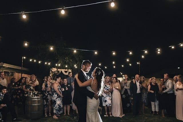 Recently hitched couple sharing their first dance in the DIY backyard property wedding