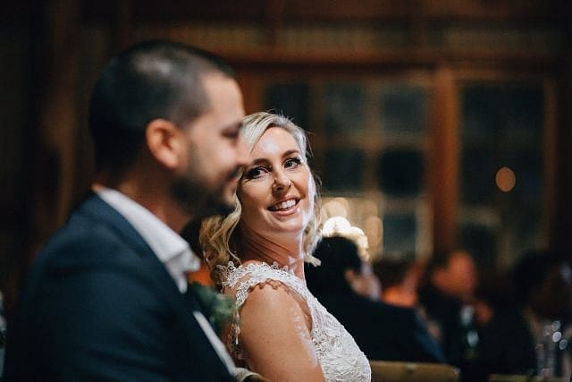 Bride lovingly stares at Groom during their celebrations