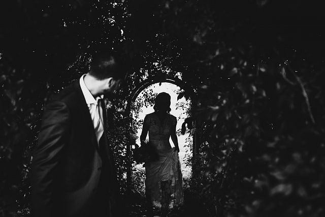 Groom waits for bride to emerge from shadows at Albion on the Swan