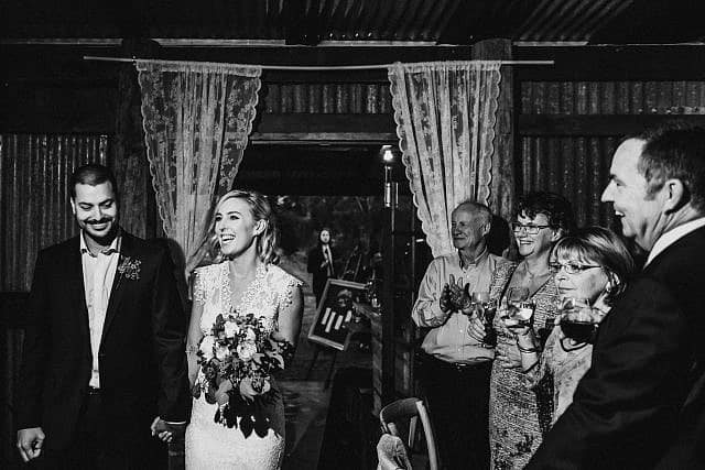 Bride enter shed at Albion on Swan for their Reception with family & Friends cheering