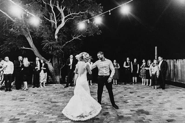 Bride Spins while dancing with Groom for their first dance at Albion on Swan outdoor under stars and lights