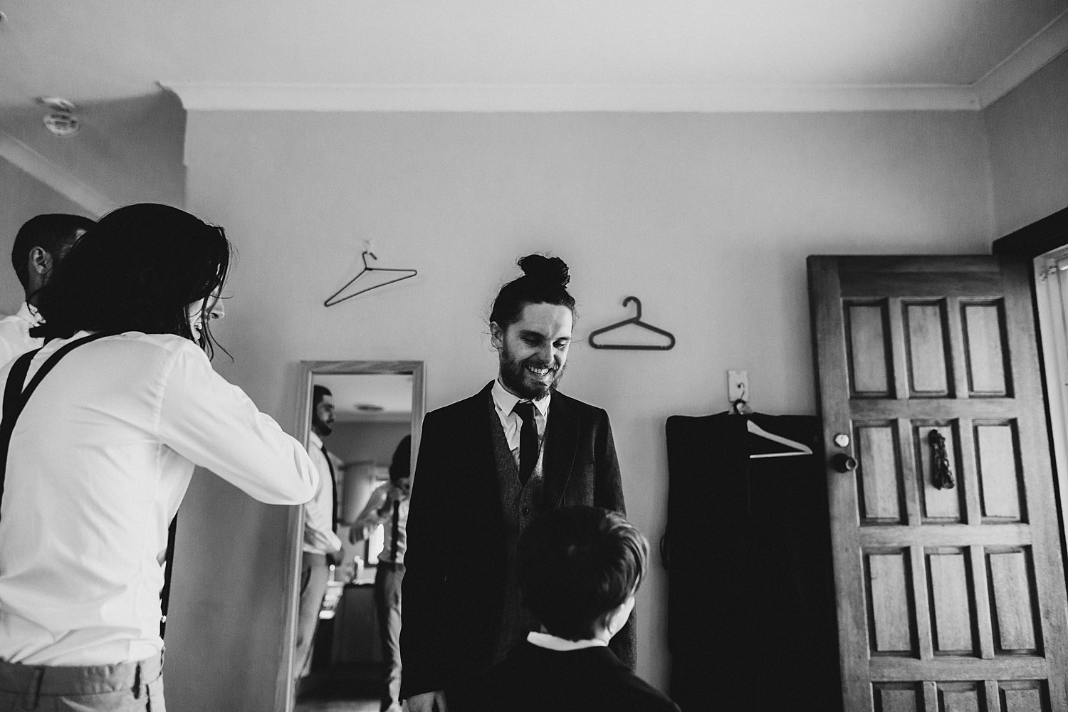 Groom Laughing At Page Boy