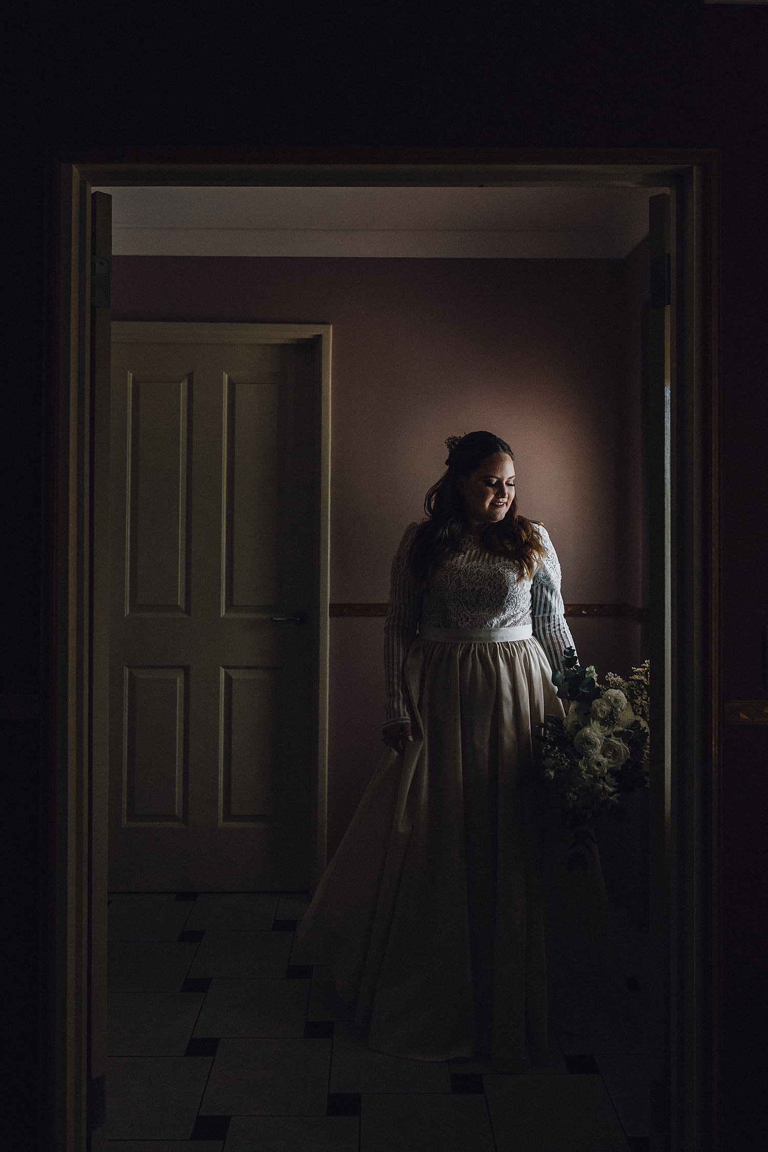 Gorgeous Moody Dark Bride Holding Bouquet