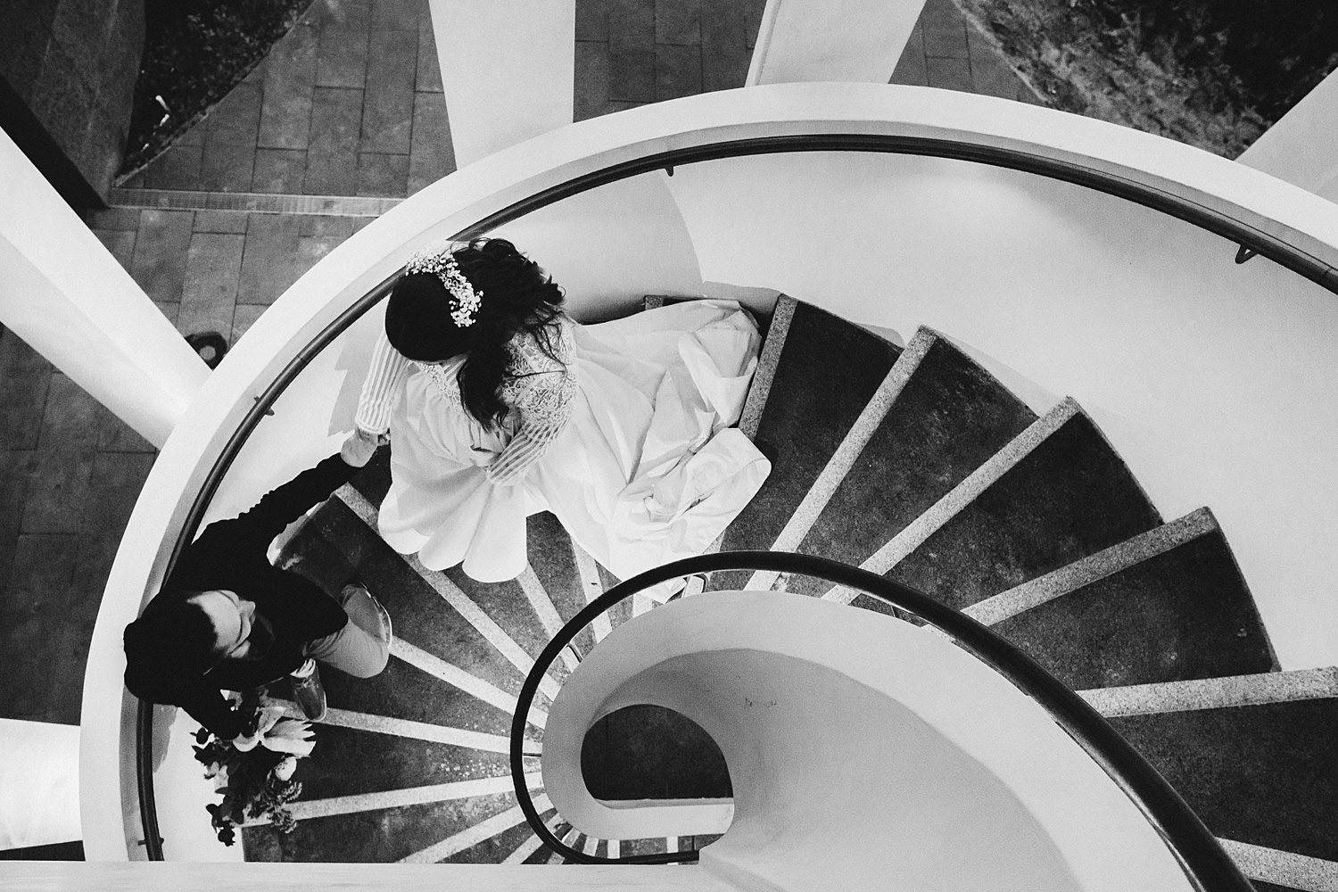 Bride & Groom Curing Down Stairs In City