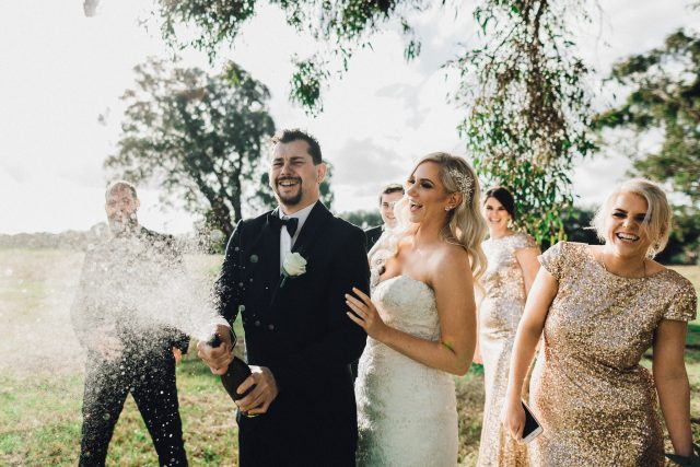groom sprays champagne wedding swan valley