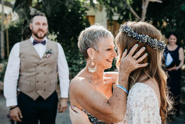 Mother Of Bride Kissing Daughter